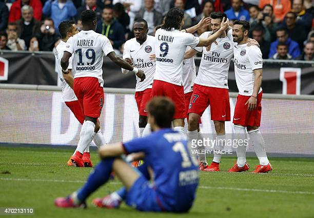 Paris SaintGermain's Argentinian midfielder Javier Pastore celebrates with teammates after scoring a goal during the French L1 football match betweem...
