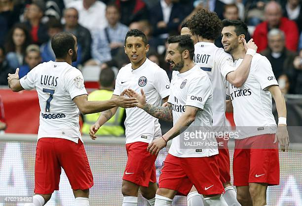 Paris SaintGermain's Argentinian midfielder Javier Pastore celebrates with teammates after scoring a goal during the French L1 football match between...