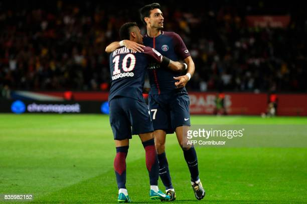Paris SaintGermain's Argentinian midfielder Javier Pastore celebrates after scoring a goal with Paris SaintGermain's Brazilian forward Neymar during...