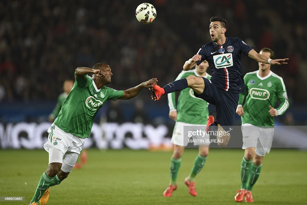 Paris Saint-Germain's Argentinian midfielder <a gi-track='captionPersonalityLinkClicked' href=/galleries/search?phrase=Javier+Pastore&family=editorial&specificpeople=5857872 ng-click='$event.stopPropagation()'>Javier Pastore</a> (R) fights for the ball with St Etienne's French defender Kevin Theophile-Catherine (L) during the French Cup semi-final football match Paris Saint-Germain (PSG) vs Saint-Etienne (ASSE) on April 8, 2015 at the Parc des Princes stadium in Paris.