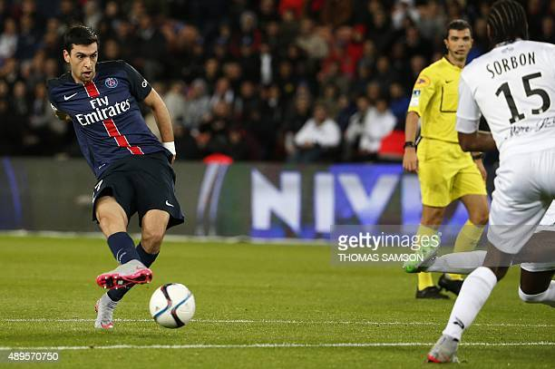 Paris SaintGermain's Argentinian midfielder Javier Pastore kicks to score a goal during the French L1 football match between Paris SaintGermain and...