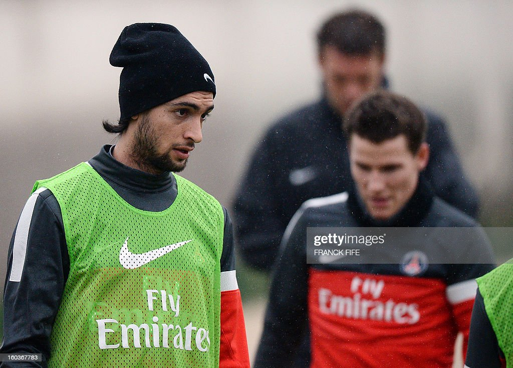 Paris Saint-Germain's Argentinian midfielder Javier Pastore (R) looks on next to Paris Saint-Germain's French forward Kevin Gameiro during a training session on January 30, 2013 at the Camp des Loges in Saint-Germain-en-Laye, west of Paris.