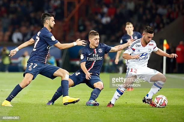Paris SaintGermain's Argentinian midfielder Javier pastore Paris SaintGermain's Italian midfielder Marco Verratti and Lyon's French midfielder Jordan...