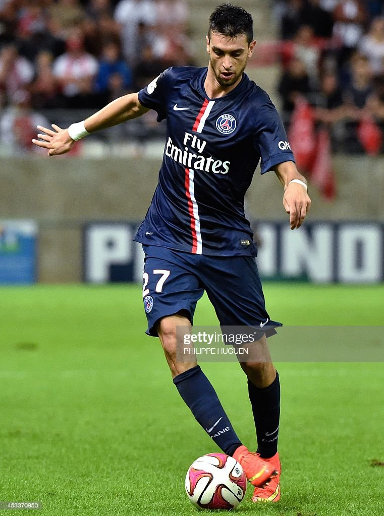 Paris Saint-Germain's Argentinian midfielder Javier Pastore plays with the ball during a French L1 football match between Reims and Paris Saint-Germain (PSG), on August 8, 2014 at the Auguste Delaune Stadium in Reims.