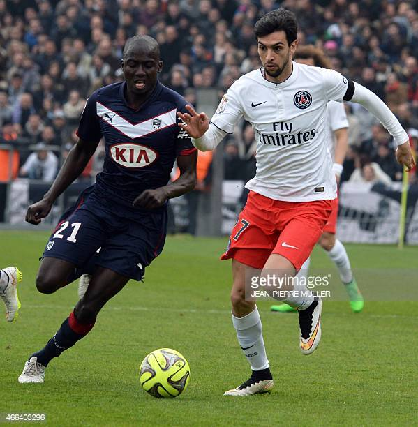Paris SaintGermain's Argentinian midfielder Javier Pastore vies for the ball with Bordeaux's French defender Cedric Yambere during the French L1...