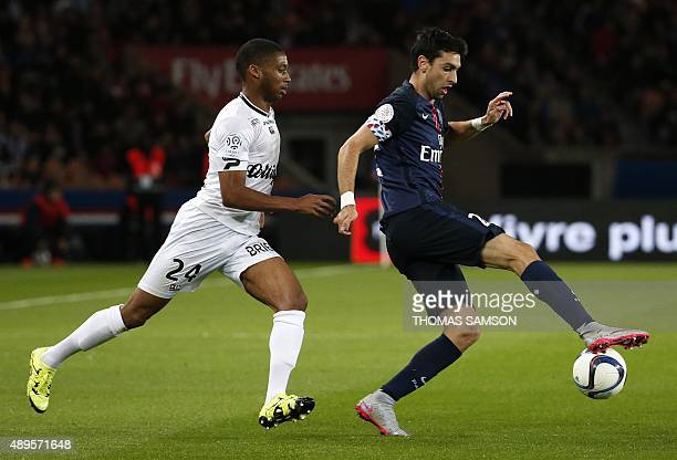 Paris SaintGermain's Argentinian midfielder Javier Pastore vies with Guigamp's Marcus Coco during the French L1 football match between Paris...