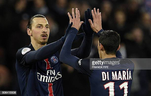 Paris SaintGermain's Argentinian Swedish forward Zlatan Ibrahimovic is congratulated by Paris SaintGermain's Argentinian forward Angel Di Maria after...
