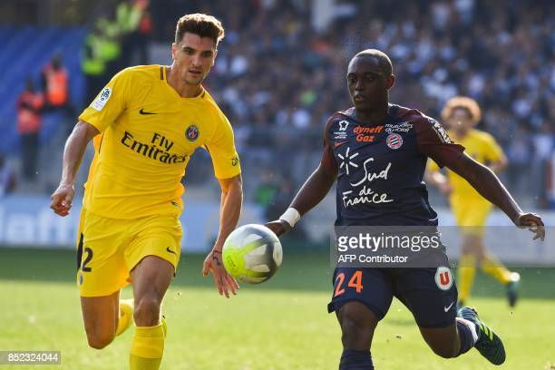 Paris SaintGermain's Belgian defender Thomas Meunier and Montpellier's French defender Jérôme Roussillon eye the ball during the French Ligue 1...