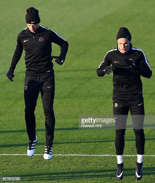 Paris SaintGermain's Belgian defender Thomas Meunier and Paris SaintGermain's Uruguayan forward Edinson Cavani take part in a training session on...