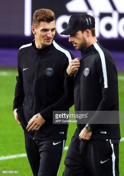 Paris SaintGermain's Belgian defender Thomas Meunier and Paris SaintGermain's Belgian defender Thomas Meunier walk on the pitch in Brussels on...