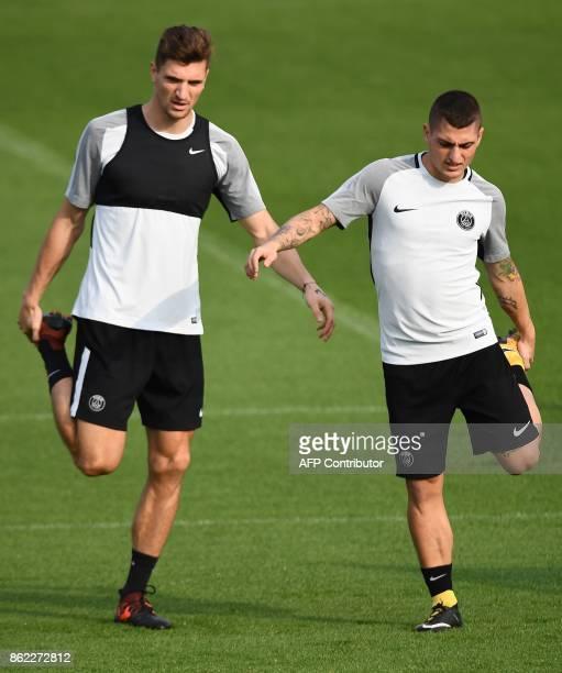 Paris SaintGermain's Belgian defender Thomas Meunier and PSG's Italian midfielder Marco Verratti attend a training session on October 17 2017 in...