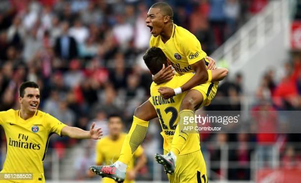 TOPSHOT Paris SaintGermain's Belgian defender Thomas Meunier celebrates scoring a goal with Paris SaintGermain's French forward Kylian Mbappe during...