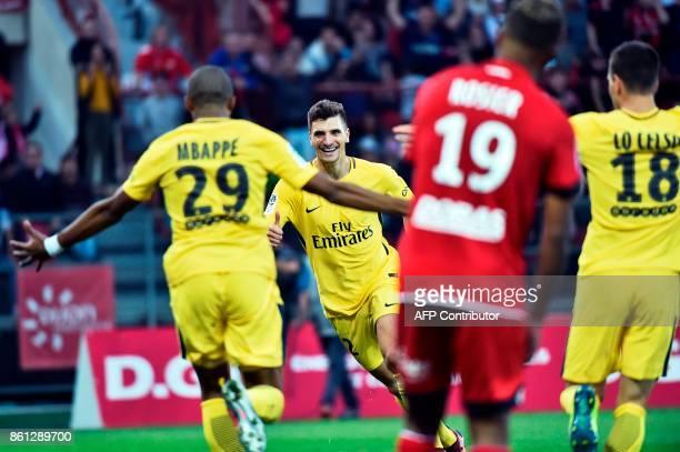 Paris SaintGermain's Belgian defender Thomas Meunier celebrates scoring a goal uring the French L1 football match between Dijon and Paris...