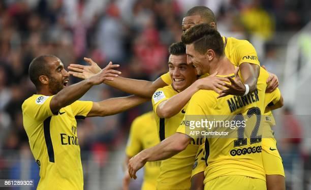 Paris SaintGermain's Belgian defender Thomas Meunier celebrates his goal with teammates during the French L1 football match between Dijon and Paris...