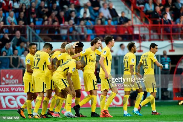 Paris SaintGermain's Belgian defender Thomas Meunier celebrates with teammates after scoring a goal during the French L1 football match between Dijon...