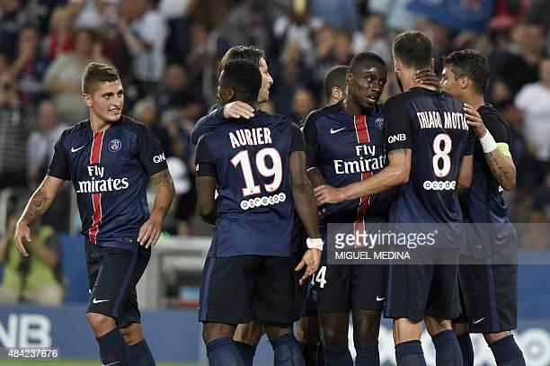 Paris SaintGermain's Brasilian defender Thiago Silva celebrates with teammates after scoring a goal during the French L1 football match between Paris...
