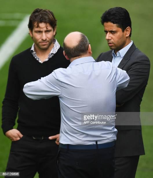 Paris SaintGermain's Brazilian assistant sporting director Maxwell and Paris SaintGermain's Qatari president Nasser AlKhelaifi talk during a training...
