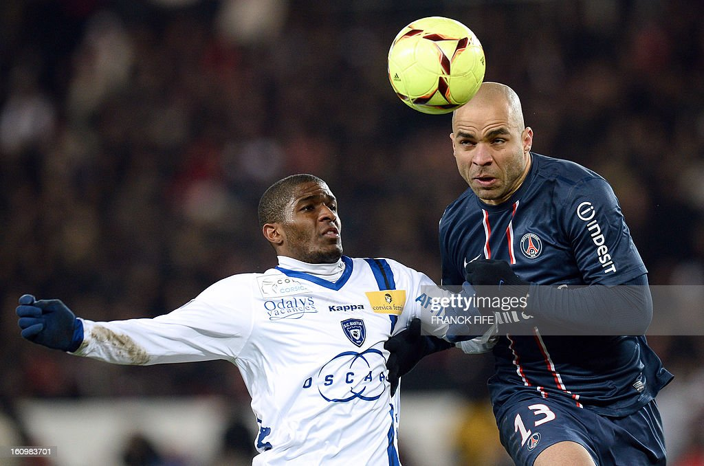 Paris Saint-Germain's Brazilian defender Alex Costa (R) vies with Bastia's French forward Anthony Modeste during the French L1 football match Paris Saint-Germain (PSG) vs Bastia, on February 8, 2013 at the Parc des Princes stadium in Paris.