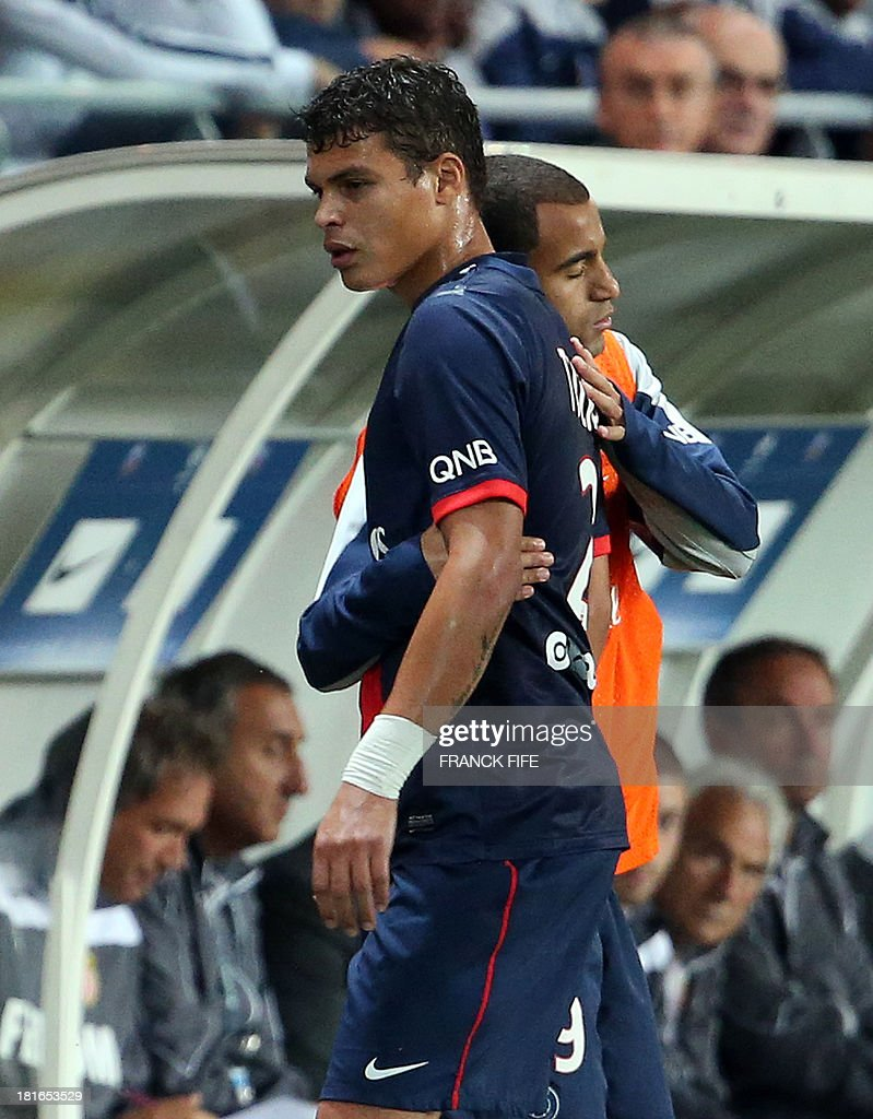 Paris Saint-Germain's Brazilian defender and captain Thiago Silva walks off the pitch after being substituted following an injury during the French L1 football match between Paris Saint-Germain and AS Monaco at the Parc des Princes Stadium in Paris on September 22, 2013. The match ended in a 1-1 draw.