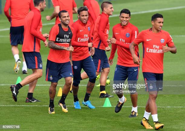Paris SaintGermain's Brazilian defender Dani Alves Brazilian forward Neymar Italian midfielder Marco Verratti Brazilian defender Thiago Silva and...