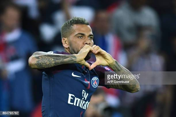 Paris SaintGermain's Brazilian defender Dani Alves celebrates scoring a goal during the UEFA Champions League football match between Paris...