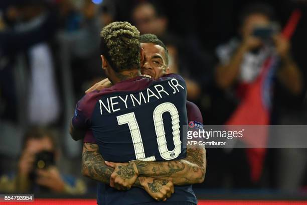 Paris SaintGermain's Brazilian defender Dani Alves celebrates scoring a goal with Paris SaintGermain's Brazilian forward Neymar during the UEFA...
