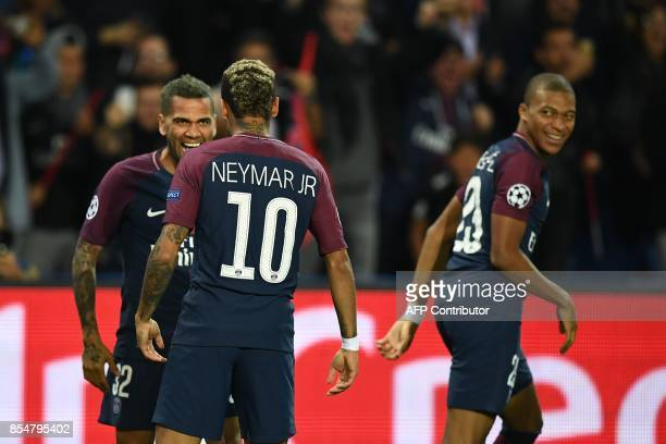Paris SaintGermain's Brazilian defender Dani Alves celebrates with Paris SaintGermain's Brazilian forward Neymar after he scored a goal as Paris...