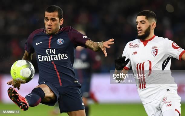 Paris SaintGermain's Brazilian defender Dani Alves controls the ball next to Lille's midfielder Yassine Benzia during the French L1 football match...
