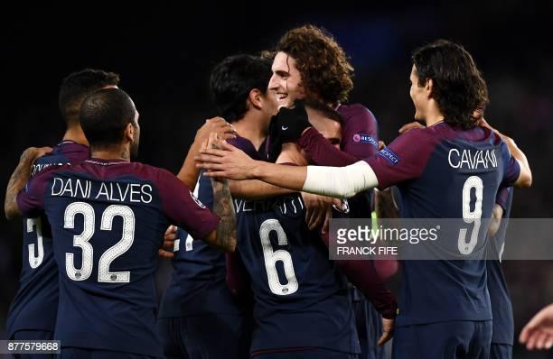 Paris SaintGermain's Brazilian defender Dani Alves Paris SaintGermain's Italian midfielder Marco Verratti Paris SaintGermain's French midfielder...
