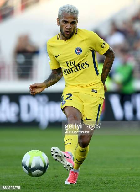 Paris SaintGermain's Brazilian defender Dani Alves passes the ball during the French L1 football match between Dijon and Paris SaintGermain at the...