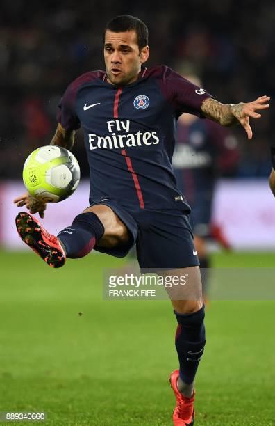 Paris SaintGermain's Brazilian defender Dani Alves plays the ball during the French L1 football match between Paris SaintGermain and Lille at the...