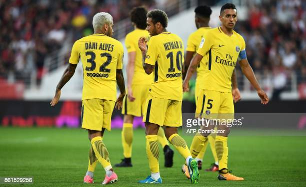 Paris SaintGermain's Brazilian defender Dani Alves speaks with Paris SaintGermain's Brazilian forward Neymar during the French L1 football match...