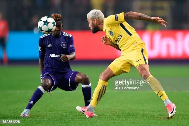 Paris SaintGermain's Brazilian defender Dani Alves vies for the ball with Anderlecht's Nigerian forward Henry Onyekuru during the UEFA Champions...