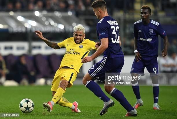 Paris SaintGermain's Brazilian defender Dani Alves vies with Anderlecht's Belgian midfielder Leander Dendoncker during the UEFA Champions League...