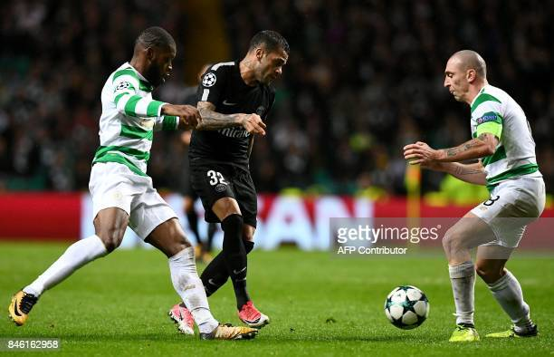 Paris SaintGermain's Brazilian defender Dani Alves vies with Celtic's French midfielder Olivier Ntcham and Celtic's Scottish midfielder Scott Brown...