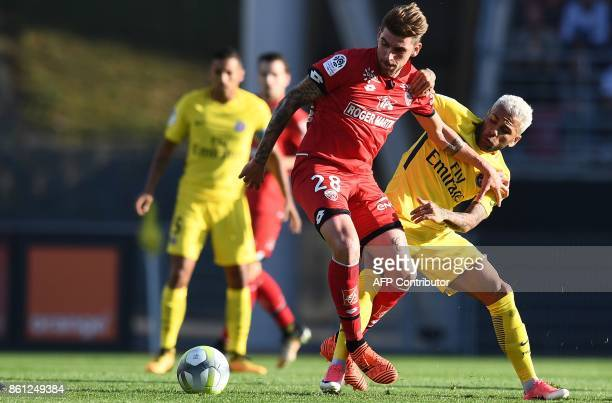 Paris SaintGermain's Brazilian defender Dani Alves vies with Dijon's French defender Cedric Varrault during the French L1 football match between...