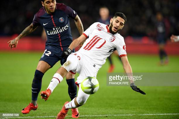 Paris SaintGermain's Brazilian defender Dani Alves vies with Lille's midfielder Yassine Benzia during the French L1 football match between Paris...