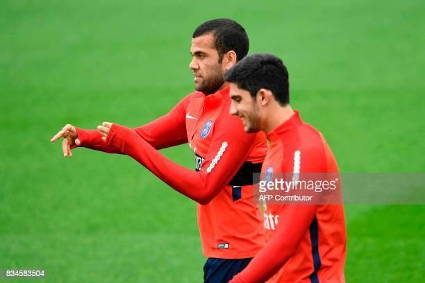 Paris SaintGermain's Brazilian defender Daniel Alves takes part in a training session at the Camp des Loges in SaintGermainenLaye near Paris on...