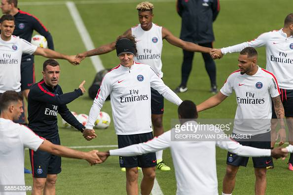 Paris SaintGermain's Brazilian defender David Luiz and teammates take part in a training session with his team mates at the CampdesLoges in...