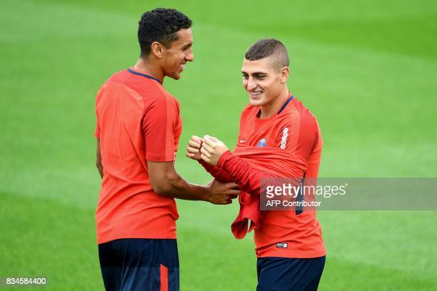 Paris SaintGermain's Brazilian defender Marquinhos and Italian midfielder Marco Verratti takes part in a training session at the Camp des Loges in...