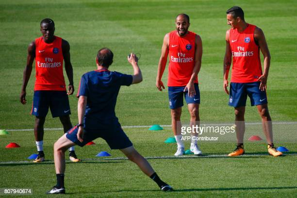 Paris SaintGermain's Brazilian defender Marquinhos and midfielder Lucas Moura take part in a training session at the Oredoo training Centre in...