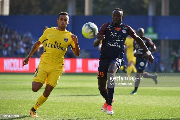 Paris SaintGermain's Brazilian defender Marquinhos and Montpellier's Chadian forward Casimir Ninga eye the ball during the French Ligue 1 football...