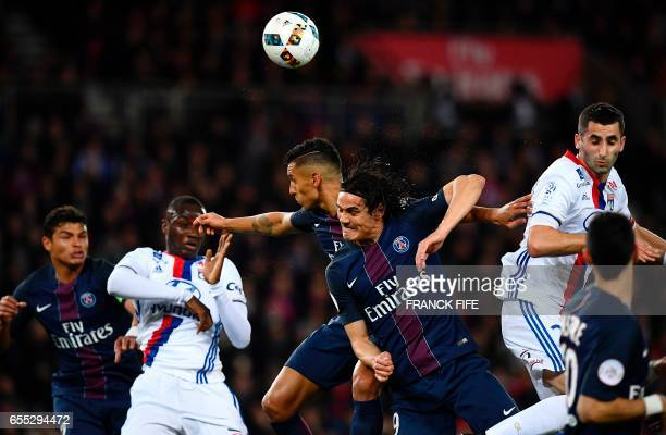 TOPSHOT Paris SaintGermain's Brazilian defender Marquinhos and Paris SaintGermain's Uruguayan forward Edinson Cavani go for a header during the...