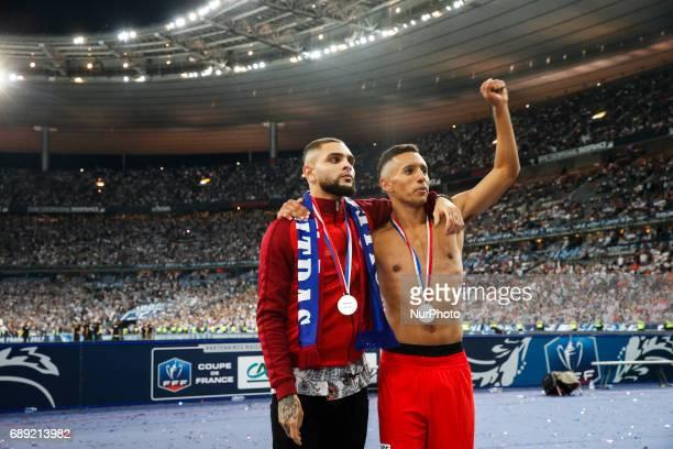 5 Paris SaintGermain's Brazilian defender Marquinhos and Paris SaintGermain's French defender Layvin Kurzawa celebrate after winning the French Cup...