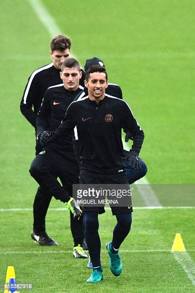 Paris SaintGermain's brazilian defender Marquinhos and Paris SaintGermain's italian midfielder Marco Verratti run during a training session at the...