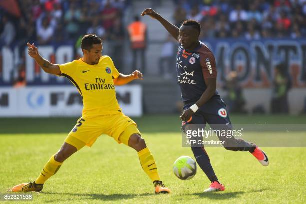 Paris SaintGermain's Brazilian defender Marquinhos defends against Montpellier's Chadian forward Casimir Ninga during the French Ligue 1 football...
