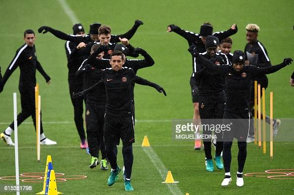 Paris SaintGermain's brazilian defender Marquinhos Paris SaintGermain's brazilian midfielder Lucas Moura and teammates stretch during a training...