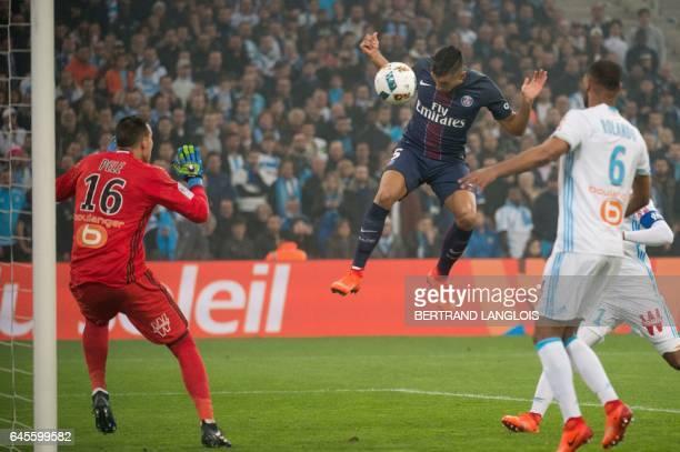 Paris SaintGermain's Brazilian defender Marquinhos scores a goal despite Olympique de Marseille's French goalkeeper Yohann Pele during the French L1...