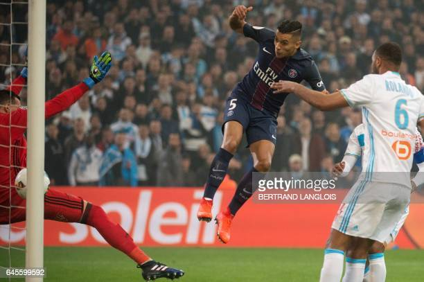 Paris SaintGermain's Brazilian defender Marquinhos scores a goal despite Olympique de Marseille's French goalkeeper Yohann Pele during the French L1...