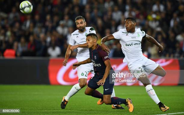 Paris SaintGermain's Brazilian defender Marquinhos vies for the ball with SaintEtienne's French defender Loic Perrin and SaintEtienne's French...